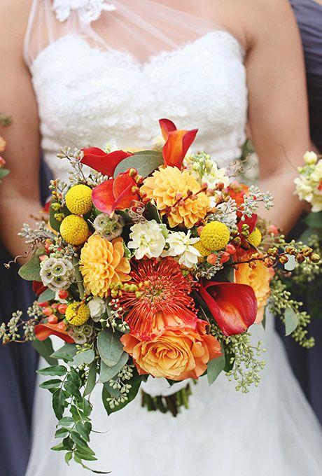 Fall wedding bouquet of calla lilies, mums, billy balls, and greenery - Wedding Belles Blog