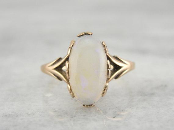 Oval Opal Engagement Ring - Wedding Belles Blog