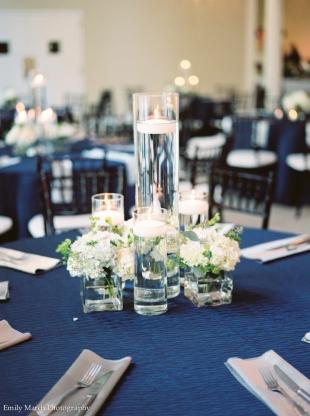 Navy linens, hydrangeas, floating candles - Wedding Belles Blog