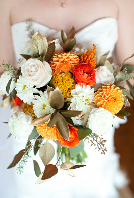 Fall wedding bouquet of ranunculus, celosia, pom-pom dahlias, Vendella roses, gilded eucalyptus leaves, and ruscus foliage - Wedding Belles Blog