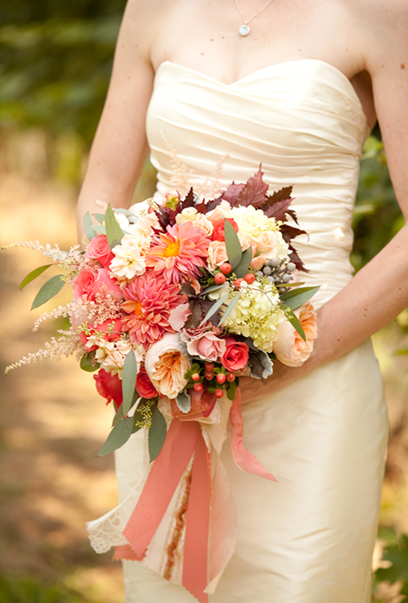 Dusty pink wedding bouquet made of garden roses, hydrangeas, hibiscus foliage, dahlias, hypericum berries, silver brunias, dusty miller, stock, seeded eucalyptus, and spray roses - Wedding Belles Blog