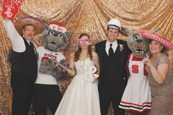 Mr. and Mrs. Wuf join the bride and groom in the photo booth - Wedding Belles Blog