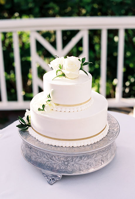 Classic Two-Tiered White Wedding Cake with Fresh Flowers, Gold Detailing, and Piping - Fairly Southern