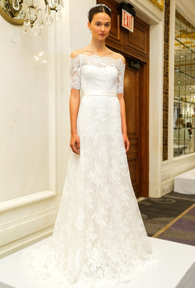 Marchesa Spring 2016 corded lace A-line wedding dress with a bateau neckline and elbow-length sleeves, via Brides - Wedding Belles Blog