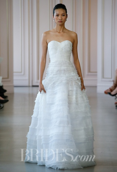 Oscar de la Renta Spring 2016 strapless lace and organza tiered ball gown wedding dress with sweetheart neckline, via Brides - Wedding Belles Blog