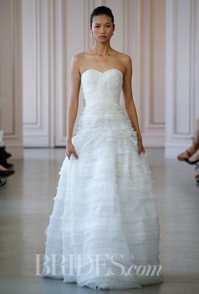 Oscar de la Renta Spring 2016 strapless lace and organza tiered ball gown wedding dress with sweetheart neckline, via Brides - Wedding Belles Blog